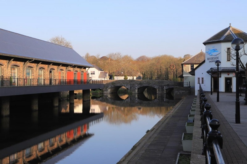 Riverside shops, New Library and the Old Bridge over the Western Cleddau
